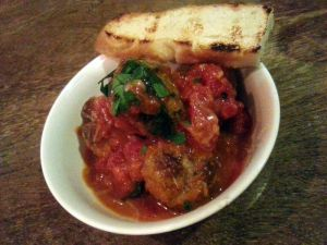 Beef meatballs sautéed in a slow-cooked tomato sauce, topped with shaved grana